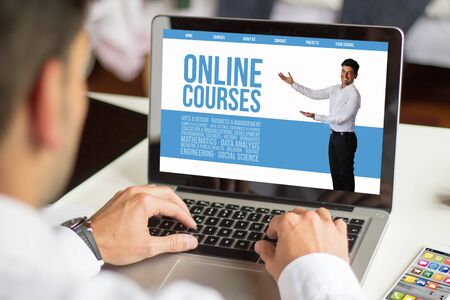 courses: businessman working with a laptop, All screen graphics are made up. online courses concept.