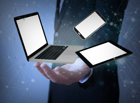 techie: responsive devices over businessman hands wih blank screen