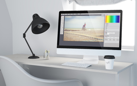 3d rendering of a desktop workplace with computer photo software. All screen graphics are made up.
