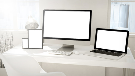 Responsive mockup screen. Monitor, laptop, tablet, phone with blank screen on table in desktop office. 3d rendering.