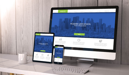 Digital generated devices on desktop, responsive business website design on screen. All screen graphics are made up. 3d rendering.