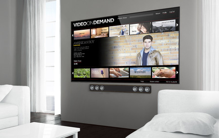 Big screen tv at living room with video on demand screen. 3d rendering. Фото со стока