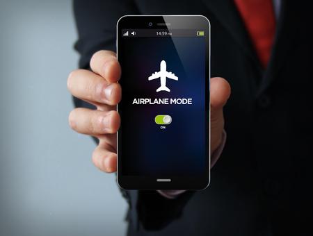 concetto di nuove tecnologie: mano di uomo d'affari che tiene un telefono touch 3D generato con modalità aereo sullo schermo. La grafica dello schermo è composta.