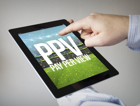 new technologies: new technologies concept: hands with touchscreen tablet withpay per view on the screen. Screen graphics are made up. Stock Photo