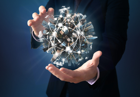 wireless tool: communications technology connection concept: tied planet on the hand of a businessman Stock Photo
