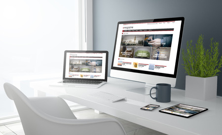 3d rendering of desktop with all devices showing modern design magazine website. All screen graphics are made up. Foto de archivo
