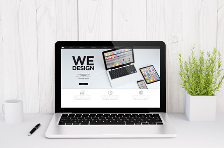 web screen: 3d rendering of a laptop with web design screen on table