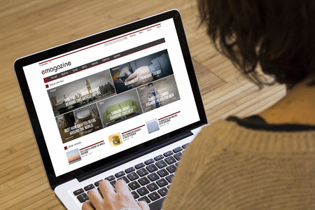 articles: magazine online concept on a laptop screen. Screen graphics are made up.