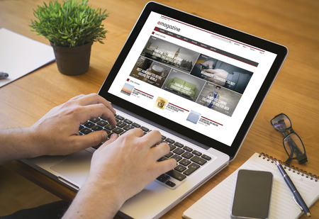 reading online concept. Close-up top view of a man working on laptop. all screen graphics are made up.