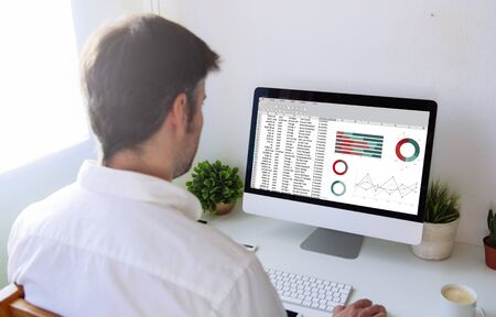 man working with computer. All screen graphics are made up. Stock Photo
