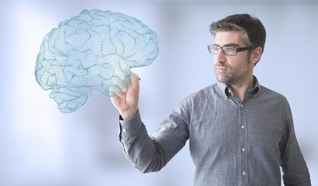 brainwaves: businessman touching brain wireframe