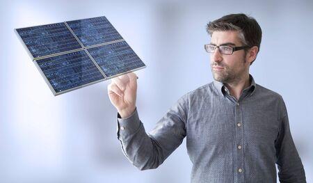 pannel: businessman touching solar pannel Stock Photo