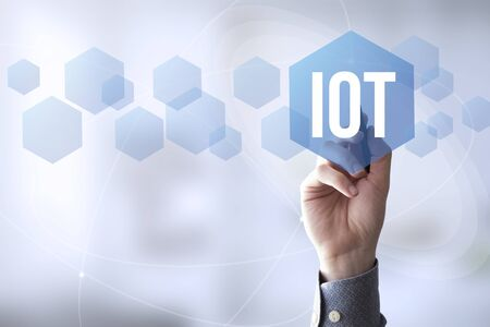 hand touching a touch screen interface with iot