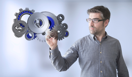 communication industry: businessman touching gears Stock Photo