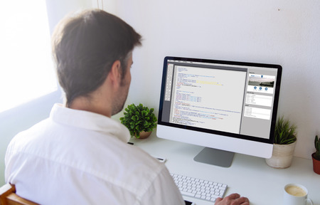 man programming a website. All screen graphics are made up.