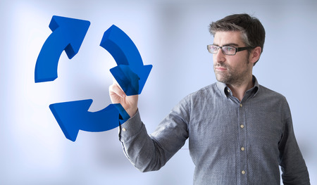 recycle sign: businessman touching recycle sign