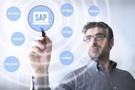 man touching a virtual screen with SAP software