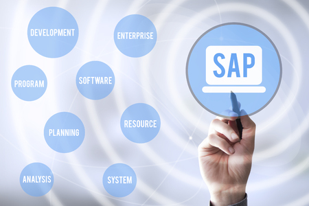 sap: hand touching a touch screen interface with virtual representation of SAP