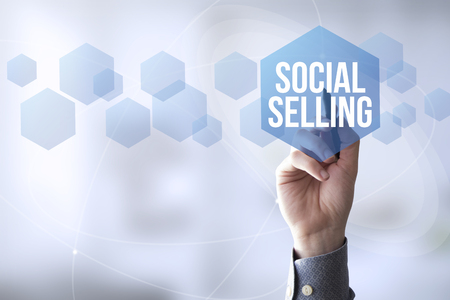 media center: hand touching a touch screen interface with social selling