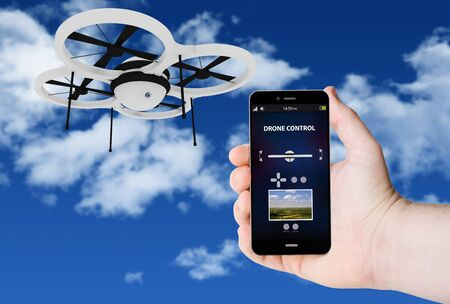 3g: Hand hold a phone with drone control on a screen on the background of a plane on sky. All screen graphics are made up. Stock Photo