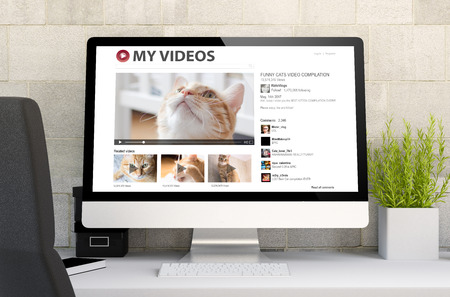 3d rendering of workspace with computer showing cat videos. All screen graphics are made up.