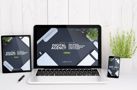 3d rendering of devices on table with responsive digital agency website design
