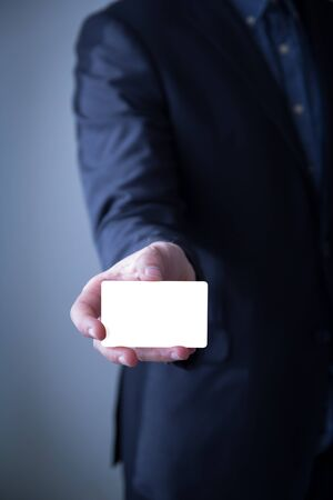 businesscard: Businessman showing blank businesscard