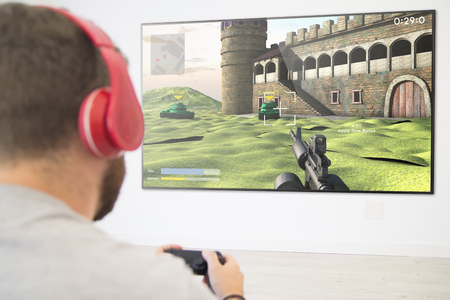 man playing online war game