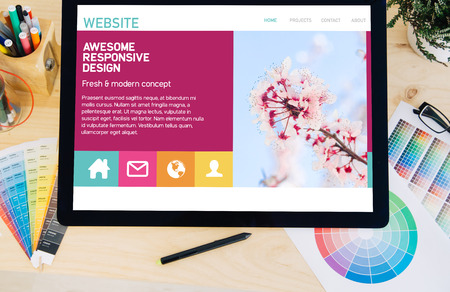 tablet pro touchscreen on desktop with website colorful on screen