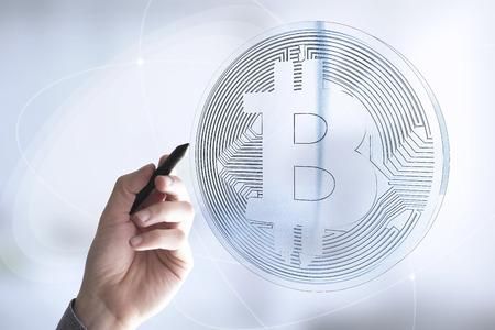 hand drawing a digital bitcoin