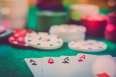 close up view of poker table with four aces