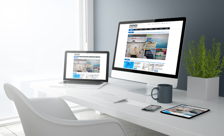 3d rendering of desktop with all devices showing cool design magazine website. All screen graphics are made up.  Stock Photo