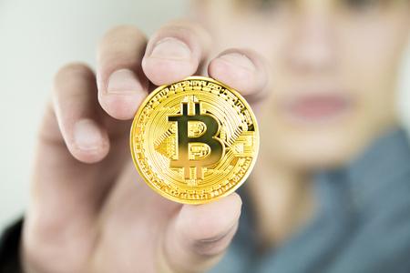 Young businessman showing bitcoin Foto de archivo