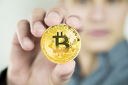Young businessman showing bitcoin Stock Photo