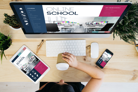 overhead view of woman drinking coffee and devices showing responsive online school design