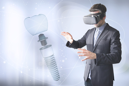 man with vr glasses designing a dental prosthesis Archivio Fotografico