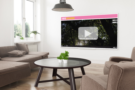 modern panoramic smart tv on a 3d rendering living room with video streaming on screen