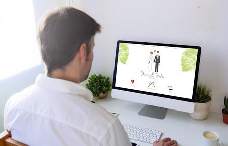 Man browsing wedding website on computer
