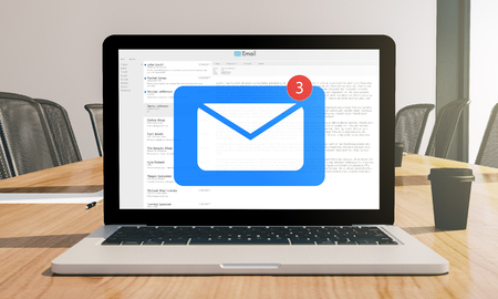 mail laptop mockup on conference room 3d rendering Stock Photo