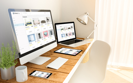 Digital generated devices over a wooden table with e-shop responsive concept. All screen graphics are made up. Reklamní fotografie