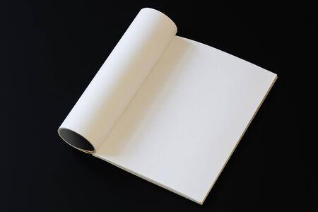 Blank magazine mock up on black table