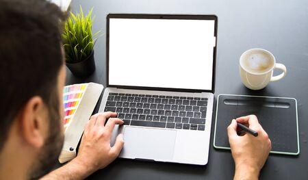 Graphic designer working on laptop mock up
