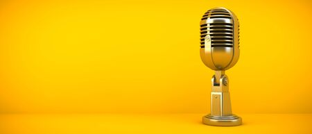 Gold microphone on yellow