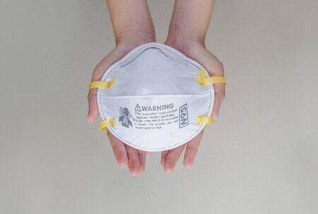 Holding medical mask and give to other peoples
