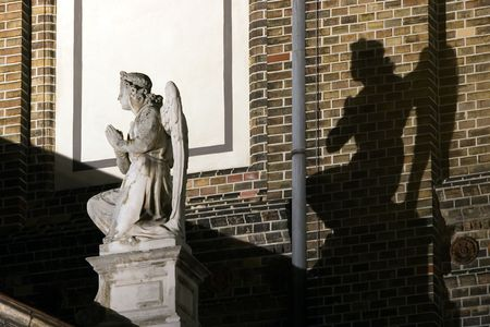 Angel statue with black angel shadow Stock Photo - 477168
