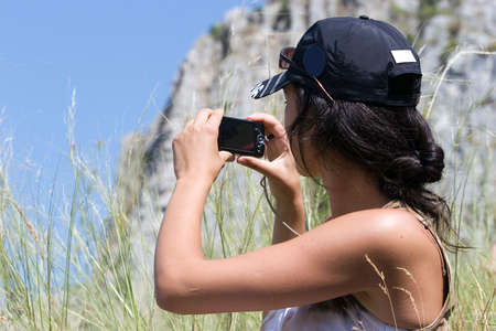 Young girl taking a snapshot photo