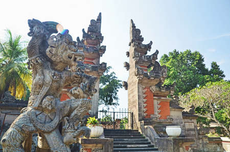 balinese: Hanoman Statue in front of Balinese gate Stock Photo