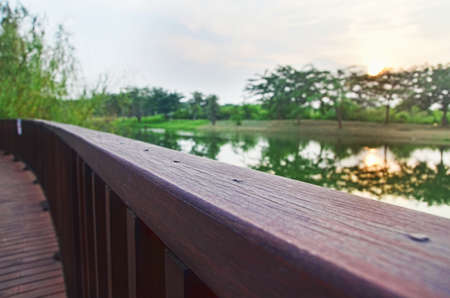 handrail: wooden handrail of viewing platform by the lake