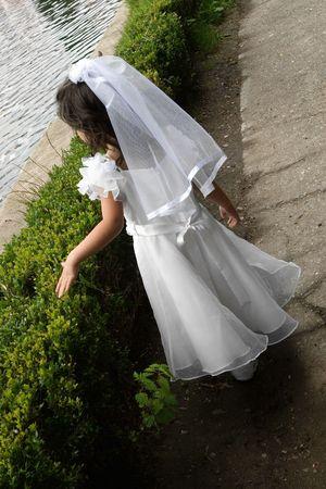 Girl walking in white wedding dress