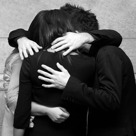 Four young friends holding each other in a privat moment photo